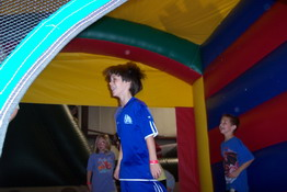 Playing in the dodge ball bouncy house