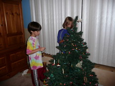 Decorating the playroom tree