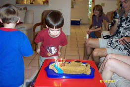 The poor kid just can't blow out candles for his life!