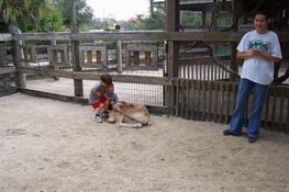 They absolutely loved petting the deer, but she kept trying to eat their shirts!