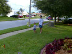 Alex and Daddy playing horseshoes