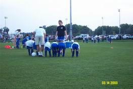 In order to make sure all the kids have on their shin guards, the ref has them all bend over and knock on their shins.