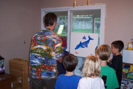 Mark spinning the blindfolded kids for Pin the Fin on the Dolphin