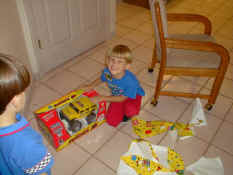 Alex with his new remote control truck from Troy, Christy and Lexie